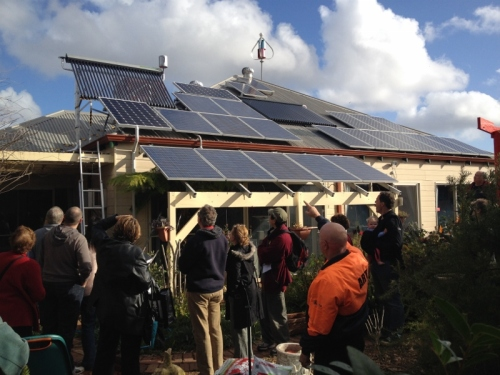 Admiring the solar PV, vacuum tubes and wind turbine on Martin's north facing roof