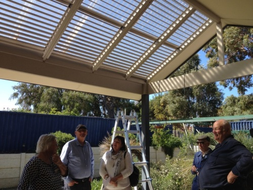 Solar pergola has slats fixed at 35degrees for winter sun but summer shade Alsinite over the pergola provides light but shelter from rain