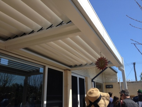 Adjustable louvres let in low-angled winter sun and provide shade in summer