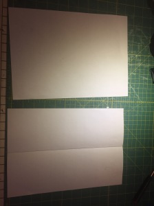 To make your pattern, take two A4 sheets of paper and fold one in half.