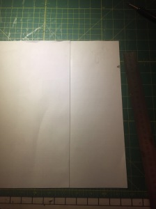 Glue your two sheets together at the centre line. Mark the right hand edge at 6cm.
