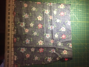 Using straight stitch, sew along the bottom and left hand side of the bag.